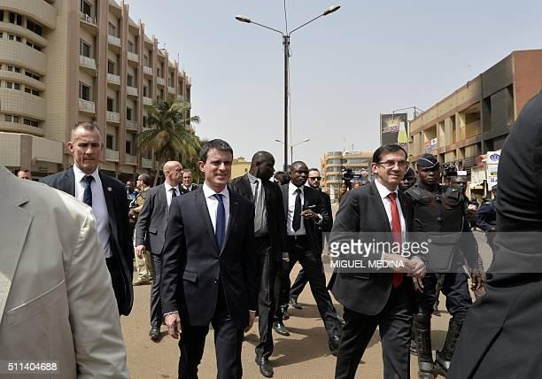 French Prime Minister Manuel Valls and France's Ambassador to Burkina Faso Gilles Thibault walk on the Kwamen Nkurman Avenue between the Splendid...