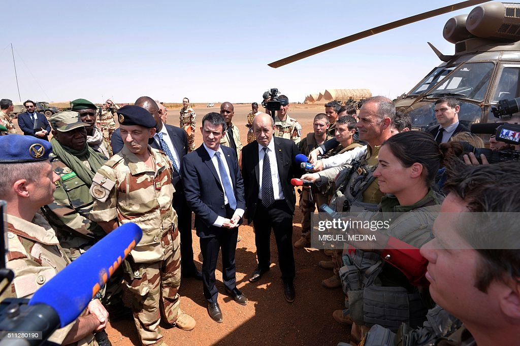 French Prime Minister Manuel Valls and French Defence Minister JeanYves Le Drian listen at soldiers during his visit to the troops of France's...