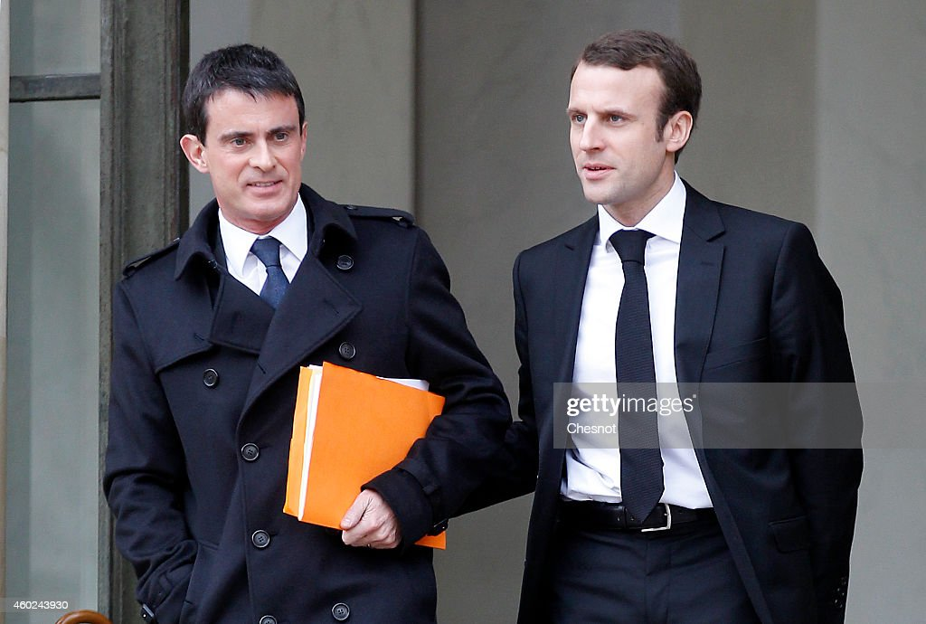 French Prime minister <a gi-track='captionPersonalityLinkClicked' href=/galleries/search?phrase=Manuel+Valls&family=editorial&specificpeople=2178864 ng-click='$event.stopPropagation()'>Manuel Valls</a> (L) and French Economy and Industry minister <a gi-track='captionPersonalityLinkClicked' href=/galleries/search?phrase=Emmanuel+Macron&family=editorial&specificpeople=9899223 ng-click='$event.stopPropagation()'>Emmanuel Macron</a> leave after the weekly cabinet meeting at the Elysee presidential palace on December 10, 2014 in Paris, France.