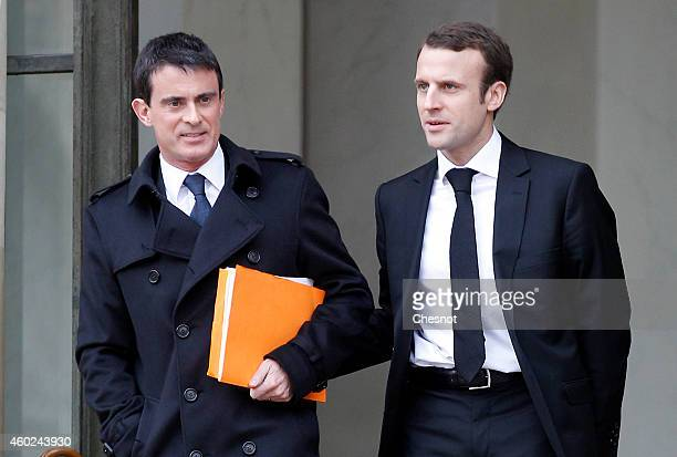 French Prime minister Manuel Valls and French Economy and Industry minister Emmanuel Macron leave after the weekly cabinet meeting at the Elysee...