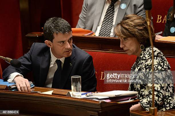 French Prime Minister Manuel Valls and French Health Minister Marisol Touraine confer during a debate on a bill about terminallyill patients'...
