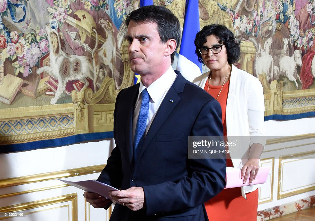 French Prime Minister Manuel Valls (L) and French Labour Minister Myriam El Khomri (R), leave after a press conference at the Hotel Matignon in Paris on June 29, 2016 following a meeting with Trade Unions' leaders on the Socialist government's labour reforms. / AFP / DOMINIQUE