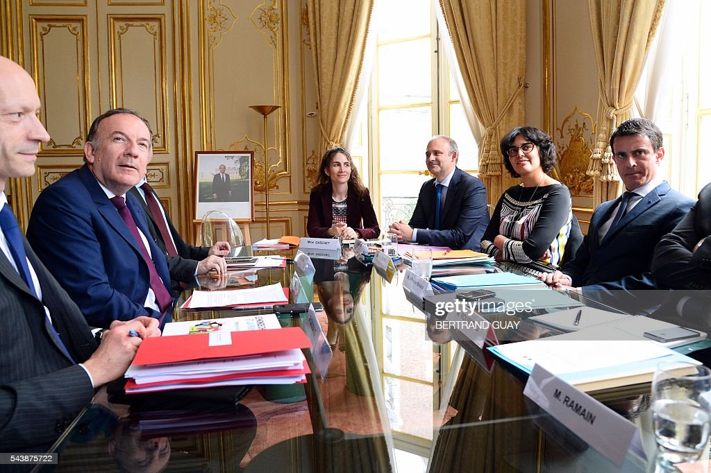 French Prime Minister Manuel Valls (R) and French Labour Minister Myriam El Khomri (2nd R) meet with head of the French Employers Federation Medef, Pierre Gattaz (2nd L) on June 30, 2016 at the Hotel Matignon in Paris. French President Francois Hollande said last week that his Socialist government would 'go all the way' to enact the labour reforms, which are seen by critics as too pro-business and a threat to cherished workers' rights. / AFP / BERTRAND