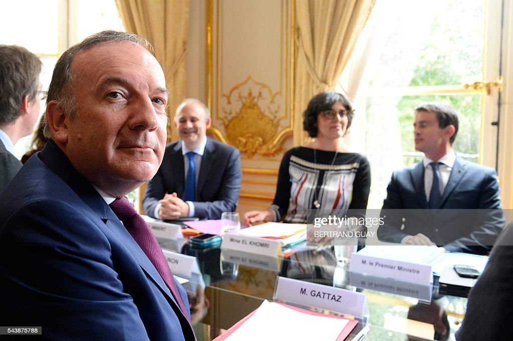 French Prime Minister Manuel Valls (R) and French Labour Minister Myriam El Khomri (2nd R) meet with head of the French Employers Federation Medef, Pierre Gattaz (L) on June 30, 2016 at the Hotel Matignon in Paris. French President Francois Hollande said last week that his Socialist government would 'go all the way' to enact the labour reforms, which are seen by critics as too pro-business and a threat to cherished workers' rights. / AFP / BERTRAND