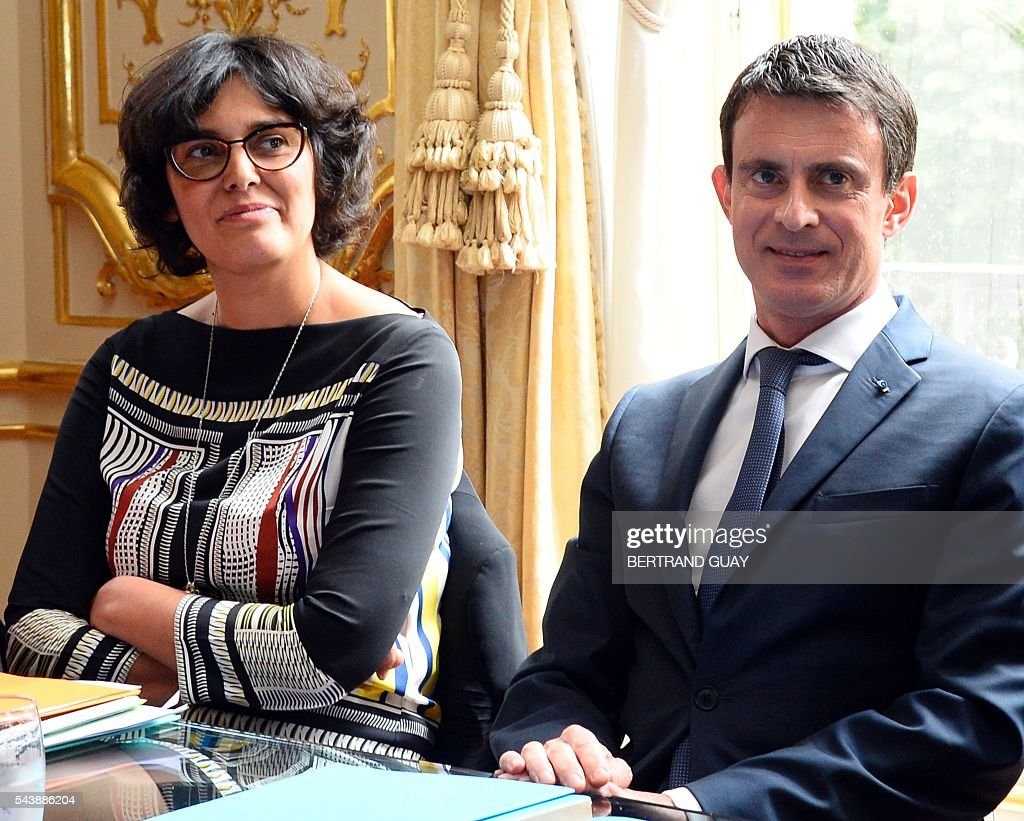 French Prime Minister Manuel Valls (R) and French Labour Minister Myriam El Khomri attend a meeting with the head of the French Employers Federation Medef on June 30, 2016 at the Hotel Matignon in Paris. French President Francois Hollande said last week that his Socialist government would 'go all the way' to enact the labour reforms, which are seen by critics as too pro-business and a threat to cherished workers' rights. / AFP / BERTRAND