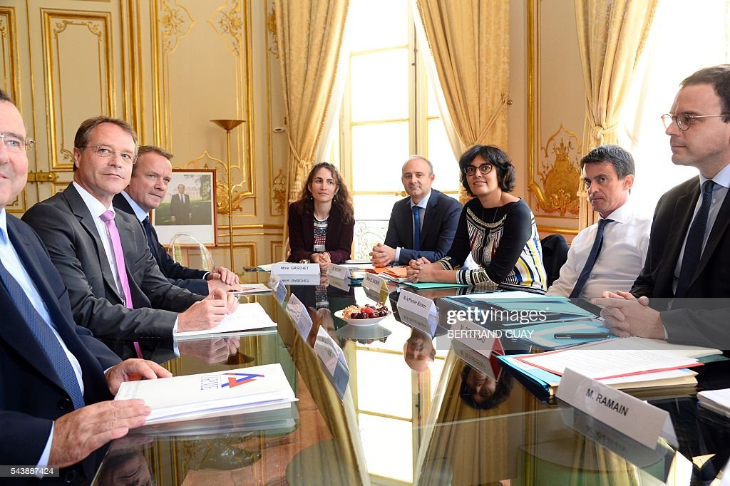 French Prime Minister Manuel Valls (2ndR) and French Labour Minister Myriam El Khomri (3rd R) attend a meeting with the head of France's small and medium-sized employers' organisation (CGPME), Francois Asselin (2nd L) on June 30, 2016 at the Hotel Matignon in Paris. French President Francois Hollande said last week that his Socialist government would 'go all the way' to enact the labour reforms, which are seen by critics as too pro-business and a threat to cherished workers' rights. / AFP / BERTRAND