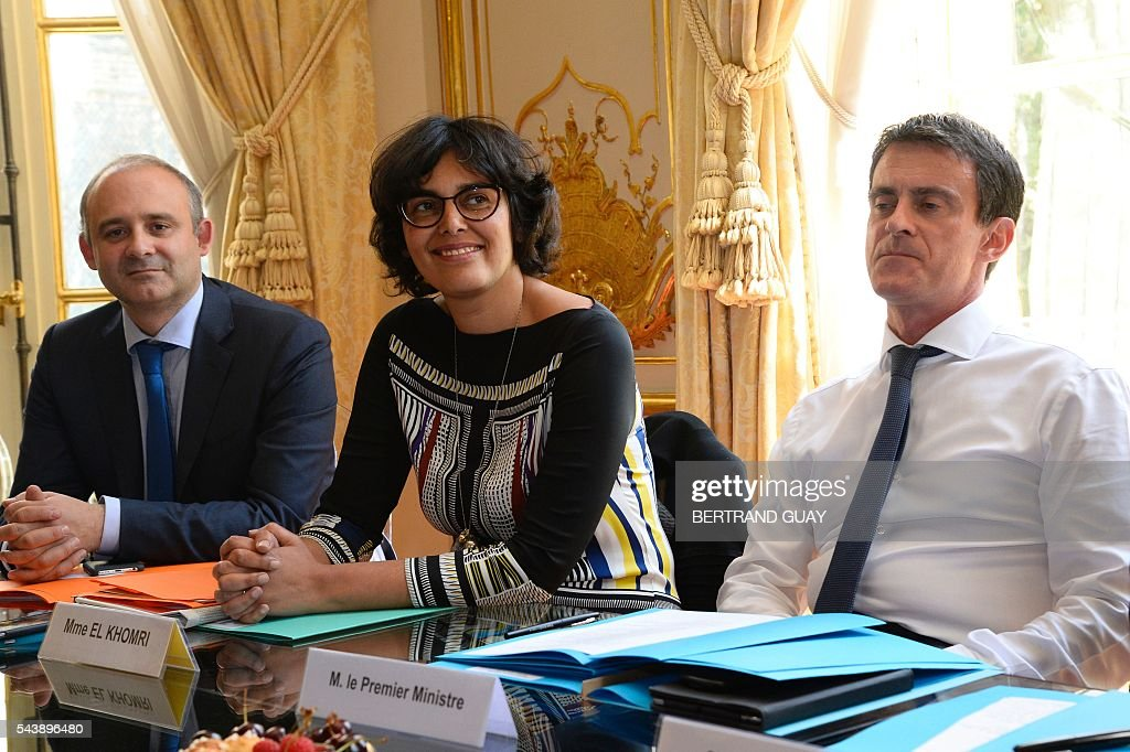 French Prime Minister Manuel Valls (R) and French Labour Minister Myriam El Khomri attend a meeting with the head of France's small and medium-sized employers' organisation (CGPME) on June 30, 2016 at the Hotel Matignon in Paris. French President Francois Hollande said last week that his Socialist government would 'go all the way' to enact the labour reforms, which are seen by critics as too pro-business and a threat to cherished workers' rights. / AFP / BERTRAND