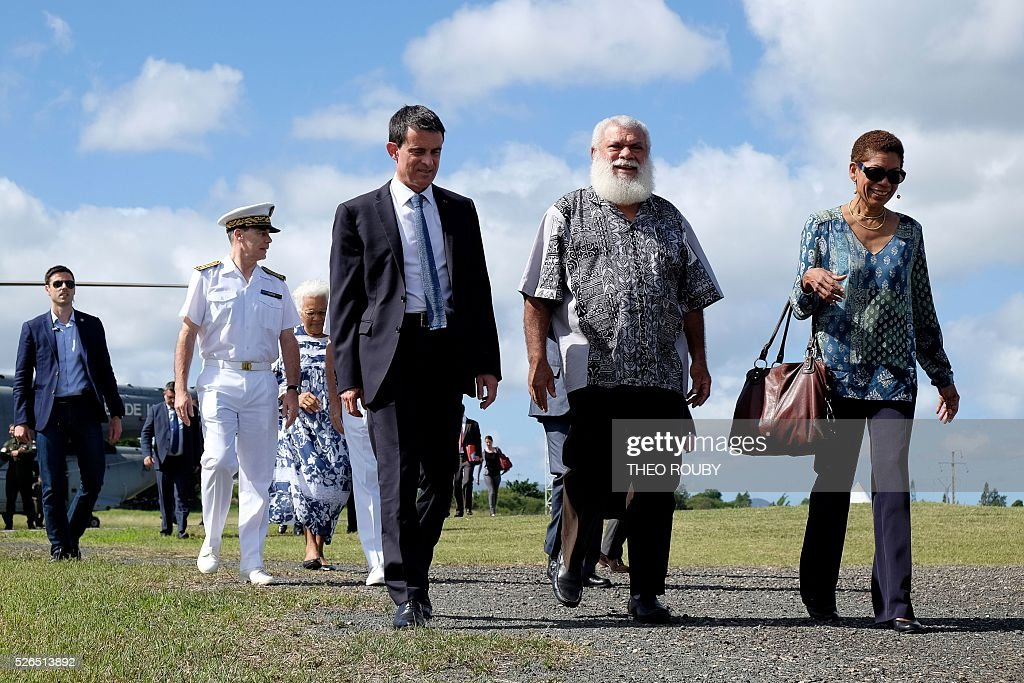 French Prime Minister Manuel Valls (3rd L) and French Minister for Overseas Territories George Pau-Langevin (R) are greeted by the president of French Minister for Overseas Territories George Pau-Langevin Paul Neaoutyine (C) April 30, 2016 in Kone, as part of their visit to the French Pacific territory of New Caledonia. / AFP / Th��o Rouby