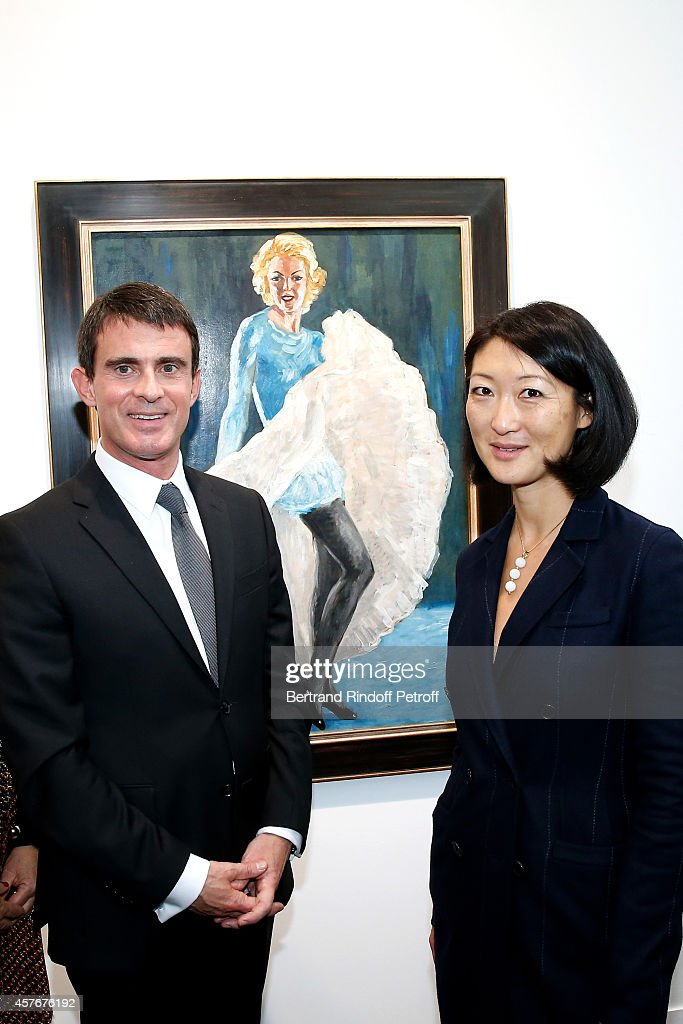 French Prime Minister Manuel Valls and French minister of Culture and Communication Fleur Pellerin attend the FIAC 2014 - International Contemporary Art Fair - : Official Opening at Le Grand Palais on October 22, 2014 in Paris, France.