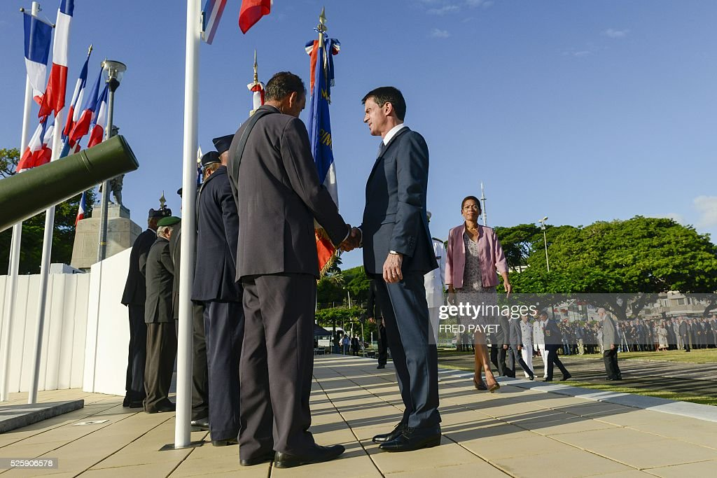 French Prime Minister Manuel Valls and French Overseas Territories Minister George Paul-Langevin arrive at the place Bir-Hakeim in Noumea during a wreath lane ceremony at the wall memorial on April 29, 2016. / AFP / Fred Payet