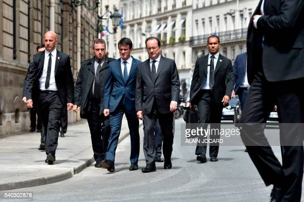 French Prime Minister Manuel Valls and French President Francois Hollande arrive at the Elysee palace on June 15 in Paris after a ceremony at the...