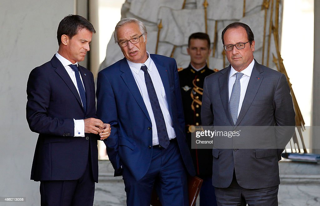 French Prime Minister <a gi-track='captionPersonalityLinkClicked' href=/galleries/search?phrase=Manuel+Valls&family=editorial&specificpeople=2178864 ng-click='$event.stopPropagation()'>Manuel Valls</a> (L) and French President Francois Hollande (R), escort former French Labour minister <a gi-track='captionPersonalityLinkClicked' href=/galleries/search?phrase=Francois+Rebsamen&family=editorial&specificpeople=590201 ng-click='$event.stopPropagation()'>Francois Rebsamen</a>, after his ultimate weekly cabinet meeting at the Elysee Presidential Palace on September 02, 2015, in Paris, France.