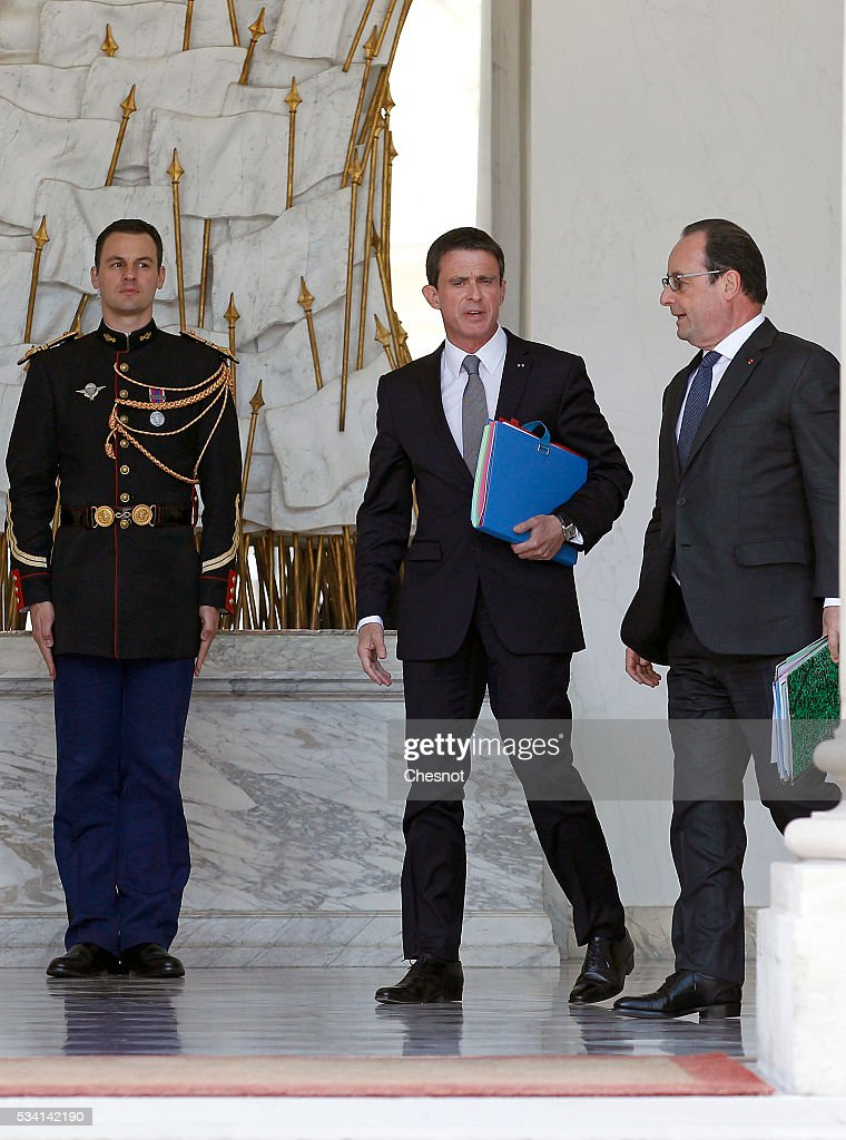 French Prime minister, <a gi-track='captionPersonalityLinkClicked' href=/galleries/search?phrase=Manuel+Valls&family=editorial&specificpeople=2178864 ng-click='$event.stopPropagation()'>Manuel Valls</a> and French President, Francois Hollande leave the Elysee Presidential Palace after a weekly cabinet meeting on May 25, 2016 in Paris, France. The French Government confirms that it tapped into its strategic reserves of petroleum products and said the equivalent of three days of inventory of 115 available had been used until now. the French government is facing a serious crisis following the El Khomri law.