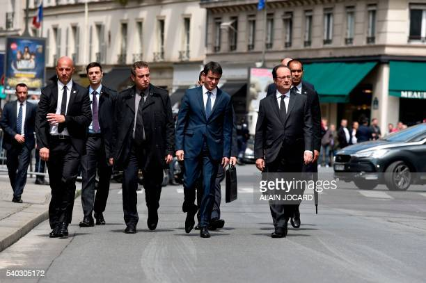 TOPSHOT French Prime Minister Manuel Valls and French President Francois Hollande walk back to the Elysee palace on June 15 in Paris after a ceremony...