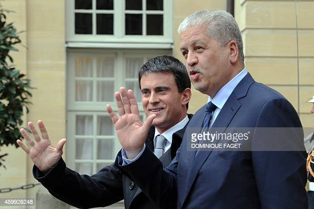 French Prime Minister Manuel Valls and his Algerian counterpart Abdelmalek Sellal wave at the end of an FrenchAlgerian meeting on December 4 2014 in...