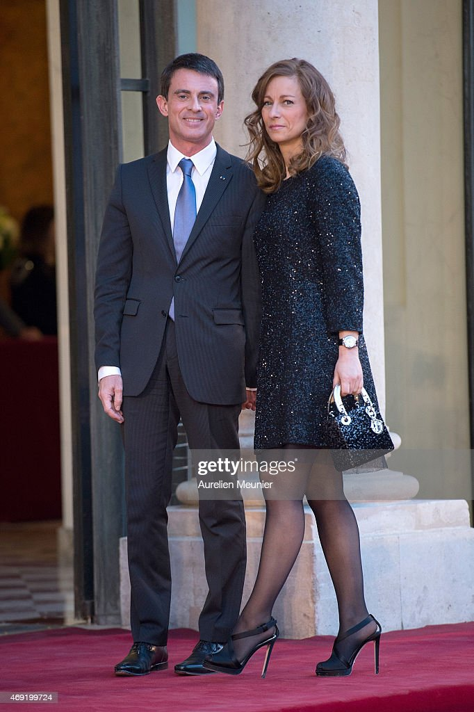 French Prime Minister Manuel Valls and his wife Anne Gravoin arrive to the Official Dinner in honor of the Prime Minister of India Narendra Modi at Elysee Palace on April 10, 2015 in Paris, France. Narendra Modi announced that India ordered 36 Rafale Firefighter War Jets ready to fly from France for an estimated 4 Billion euros with terms outlining a speedy delivery date.