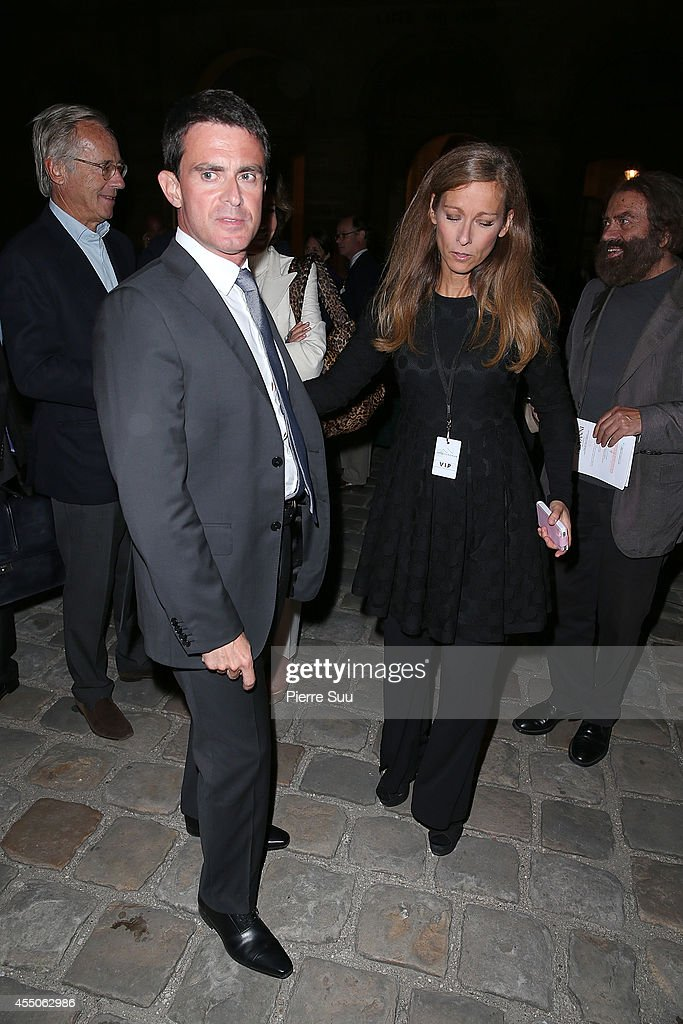 French Prime Minister <a gi-track='captionPersonalityLinkClicked' href=/galleries/search?phrase=Manuel+Valls&family=editorial&specificpeople=2178864 ng-click='$event.stopPropagation()'>Manuel Valls</a> and his wife <a gi-track='captionPersonalityLinkClicked' href=/galleries/search?phrase=Anne+Gravoin&family=editorial&specificpeople=8536985 ng-click='$event.stopPropagation()'>Anne Gravoin</a> attend 'Don Giovanni - Opera En Plein Air' at Hotel Des Invalides on September 9, 2014 in Paris, France.