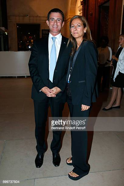 French Prime Minister Manuel Valls and his wife First violin and Orchestra Director Anne Gravoin attend the 'La Boheme Opera en Plein Air' Premiere...