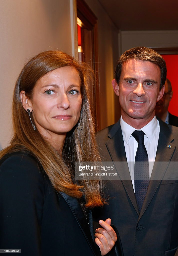 French Prime Minister <a gi-track='captionPersonalityLinkClicked' href=/galleries/search?phrase=Manuel+Valls&family=editorial&specificpeople=2178864 ng-click='$event.stopPropagation()'>Manuel Valls</a> and his wife Violonist <a gi-track='captionPersonalityLinkClicked' href=/galleries/search?phrase=Anne+Gravoin&family=editorial&specificpeople=8536985 ng-click='$event.stopPropagation()'>Anne Gravoin</a> attend 'Le Mensonge' : Theater Play. Held at Theatre Edouard VII on September 14, 2015 in Paris, France.