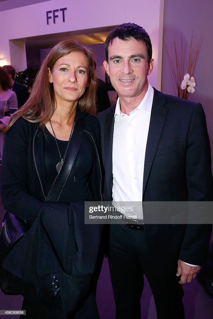 French Prime Minister <a gi-track='captionPersonalityLinkClicked' href=/galleries/search?phrase=Manuel+Valls&family=editorial&specificpeople=2178864 ng-click='$event.stopPropagation()'>Manuel Valls</a> and his wife violonist <a gi-track='captionPersonalityLinkClicked' href=/galleries/search?phrase=Anne+Gravoin&family=editorial&specificpeople=8536985 ng-click='$event.stopPropagation()'>Anne Gravoin</a> attend the Final match during day 7 of the BNP Paribas Masters. Held at Palais Omnisports de Bercy on November 2, 2014 in Paris, France.