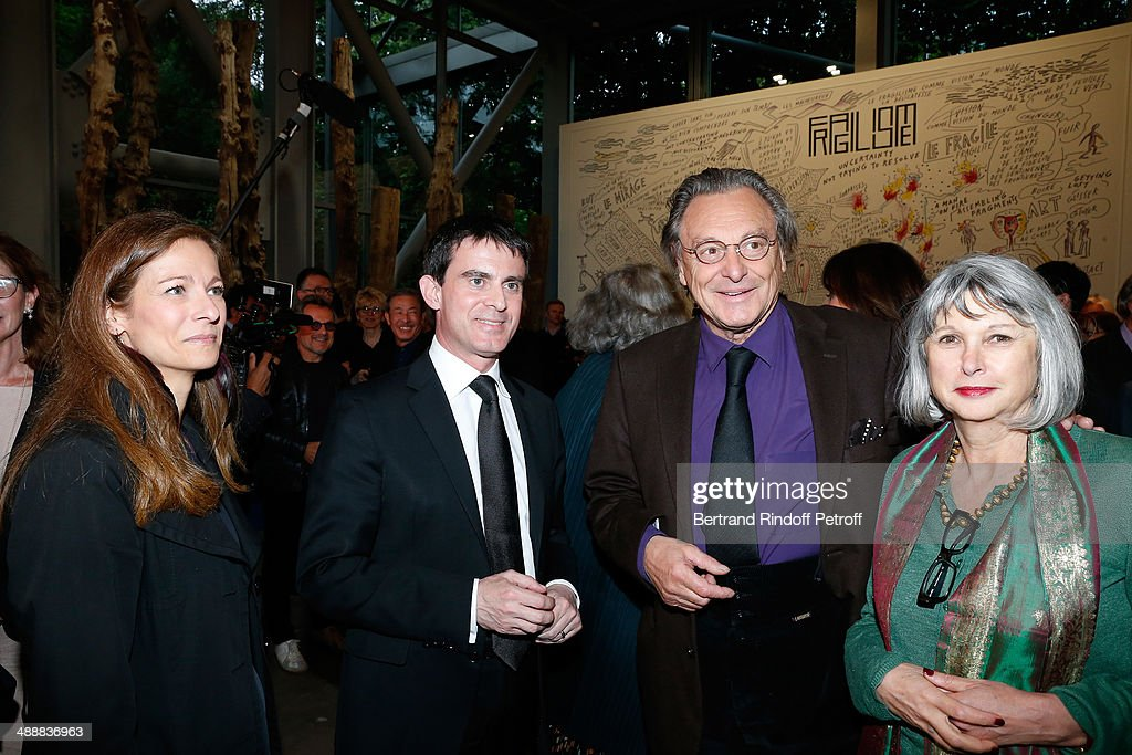 French Prime Minister <a gi-track='captionPersonalityLinkClicked' href=/galleries/search?phrase=Manuel+Valls&family=editorial&specificpeople=2178864 ng-click='$event.stopPropagation()'>Manuel Valls</a> and his wife violonist <a gi-track='captionPersonalityLinkClicked' href=/galleries/search?phrase=Anne+Gravoin&family=editorial&specificpeople=8536985 ng-click='$event.stopPropagation()'>Anne Gravoin</a> with contemporary artist Gerard Garouste and his wife Elisabeth Garouste attend the 'Fondation Cartier pour l'art contemporain' celebrates its 30th anniversary on May 8, 2014 in Paris, France.