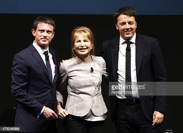 French Prime Minister Manuel Valls and Italian Prime Minister and Democratic Party leader Matteo Renzi pose with journalist Lilli Gruber during the...