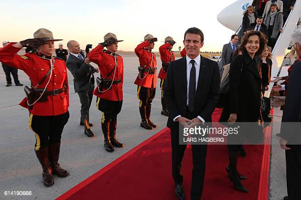 French Prime Minister Manuel Valls and Minister of Culture Audrey Azoulay look on as Royal Canadian Mounted Police officers stand at attention after...