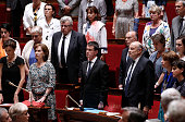 TOPSHOT French Prime minister Manuel Valls and MPs observe a minute of silence in memory of the victims of the attack in Nice on July 14 2016 during...