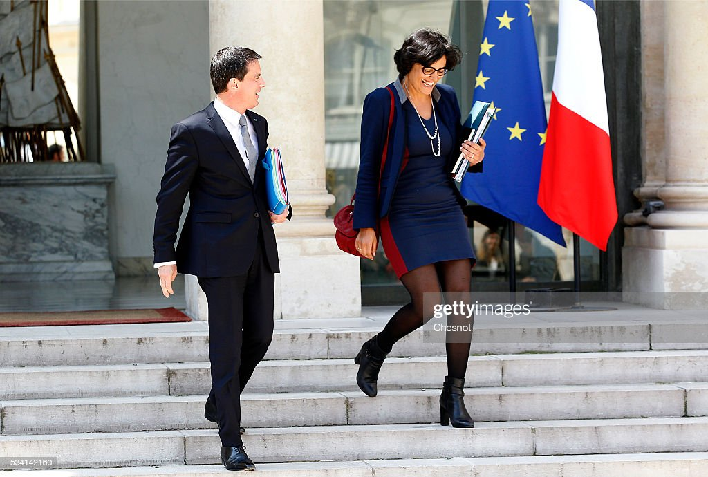 French Prime minister, <a gi-track='captionPersonalityLinkClicked' href=/galleries/search?phrase=Manuel+Valls&family=editorial&specificpeople=2178864 ng-click='$event.stopPropagation()'>Manuel Valls</a> and <a gi-track='captionPersonalityLinkClicked' href=/galleries/search?phrase=Myriam+El+Khomri&family=editorial&specificpeople=9540474 ng-click='$event.stopPropagation()'>Myriam El Khomri</a>, French Labour Minister leave the Elysee Presidential Palace after a weekly cabinet meeting on May 25, 2016 in Paris, France. The French Government confirms that it tapped into its strategic reserves of petroleum products and said the equivalent of three days of inventory of 115 available had been used until now. the French government is facing a serious crisis following the El Khomri law.
