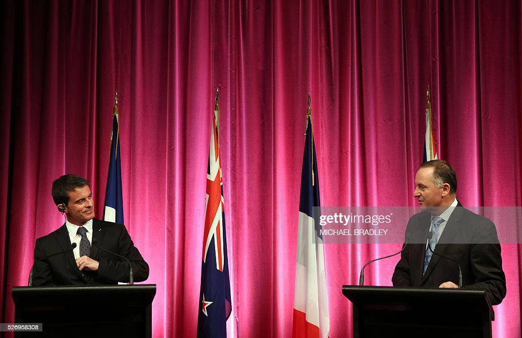 French Prime Minister Manuel Valls (L) and New Zealand Prime Minsiter John Key (R) participate in a press confernce at the Auckland War Memorial Museum in Auckland on May 2, 2016. Valls arrived in New Zealand on May 1 after visiting the French Pacific territory of New Caledonia, with officials in his delegation confirming that he will detour to Australia later today. / AFP / MICHAEL