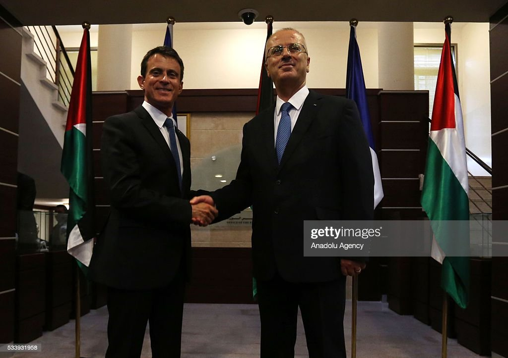 French Prime Minister Manuel Valls (L) and Palestinian Prime Minister Rami Hamdallah (R) shake hands after an official welcoming ceremony at Prime Minister's Residence in Ramallah, West Bank on May 24, 2016.