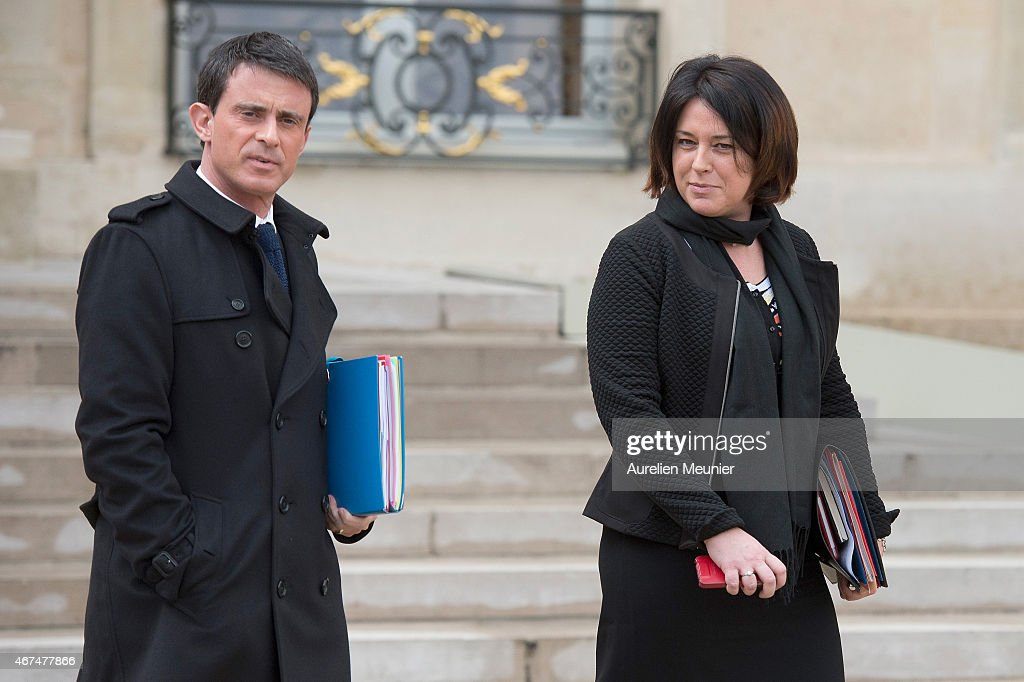 French Prime Minister <a gi-track='captionPersonalityLinkClicked' href=/galleries/search?phrase=Manuel+Valls&family=editorial&specificpeople=2178864 ng-click='$event.stopPropagation()'>Manuel Valls</a> and <a gi-track='captionPersonalityLinkClicked' href=/galleries/search?phrase=Sylvia+Pinel&family=editorial&specificpeople=9331820 ng-click='$event.stopPropagation()'>Sylvia Pinel</a> French Minister of Housing leave the Elysee Palace after the weekly cabinet meeting on March 25, 2015 in Paris, France.