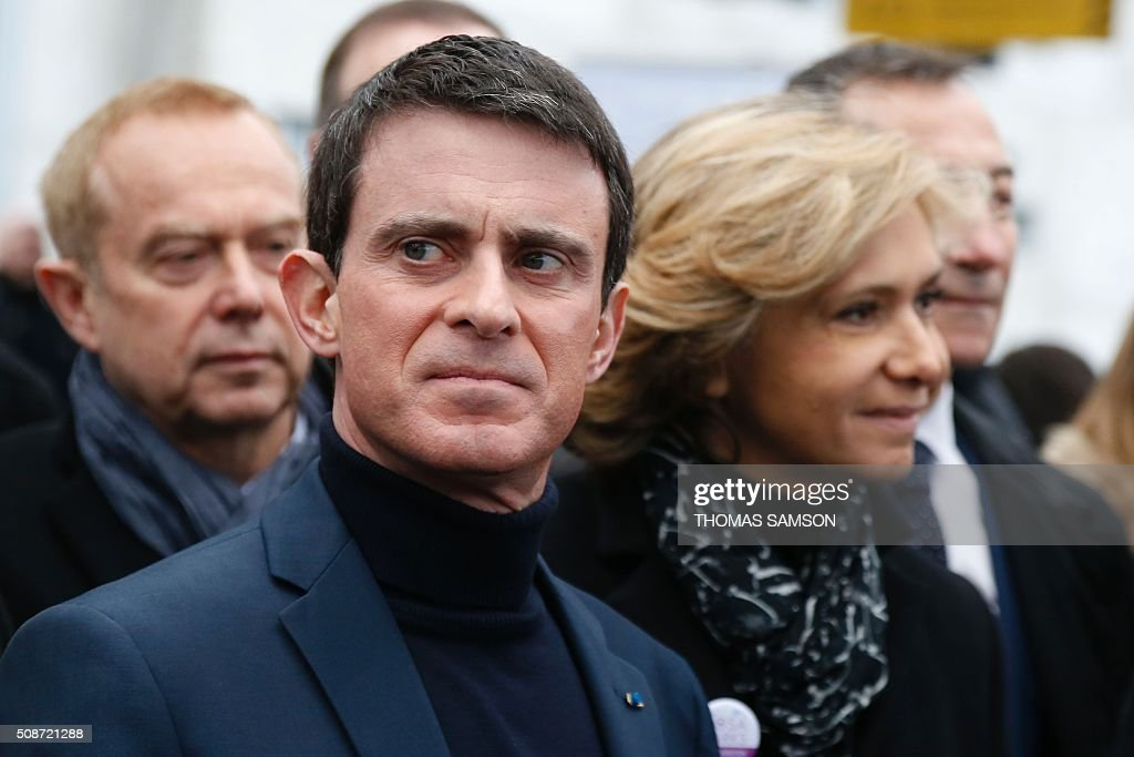 French Prime minister Manuel Valls(L) and the President of the regional council of the Ile-de-France region, Valerie Pecresse (R), attend the launching of the new Rosa Parks railway station in Paris on February 6, 2016. / AFP / THOMAS SAMSON