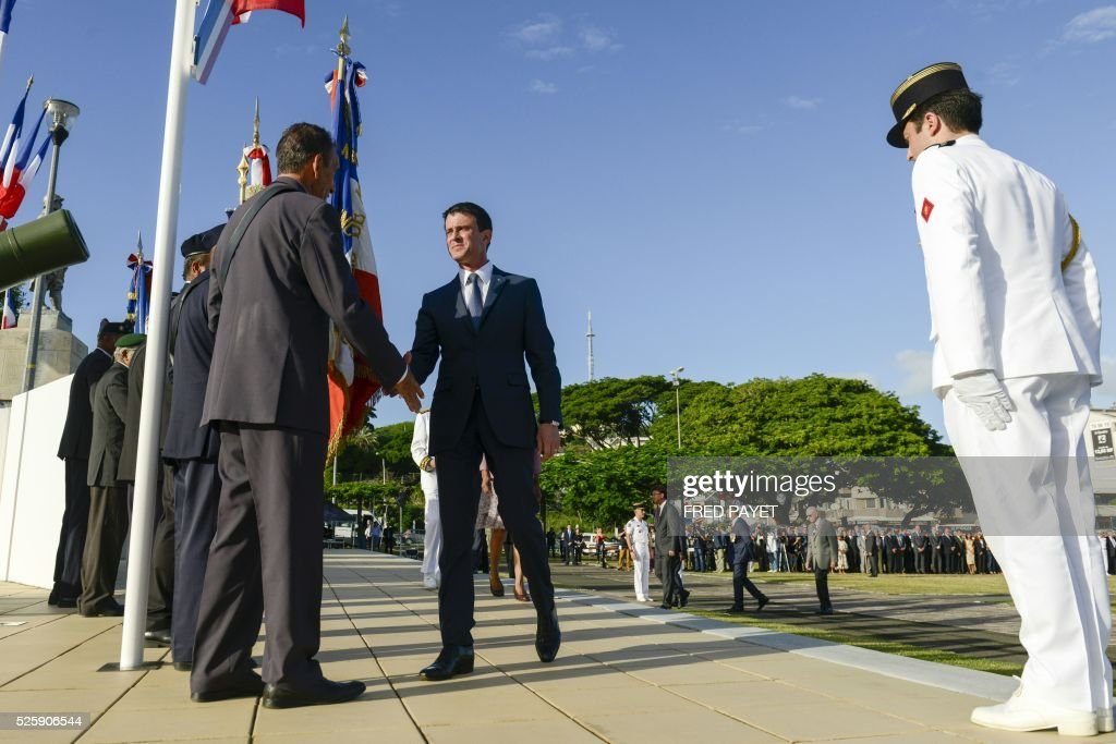 French Prime Minister Manuel Valls arives at the place Bir-Hakeim in Noumea during a wreath lane ceremony at the wall memorial on April 29, 2016. / AFP / Fred Payet
