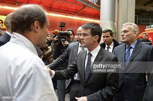 French Prime Minister Manuel Valls arrives at the University Hospital Centre of Nantes on December 23 2014 to visit victims of an attack on a...