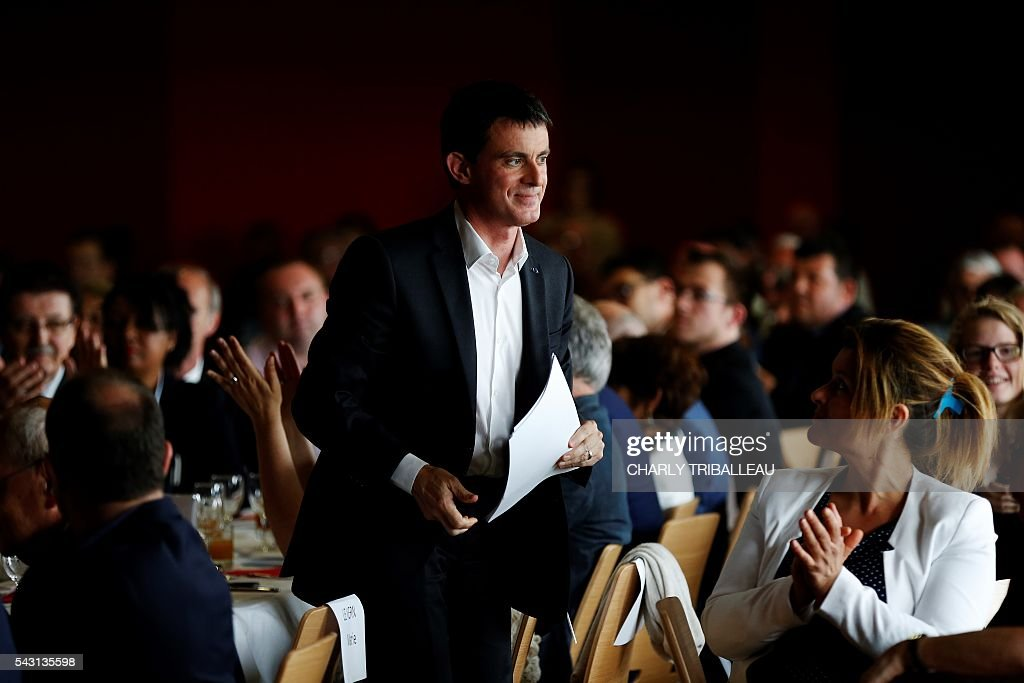 French Prime Minister Manuel Valls arrives to deliver a speech during the 'Banquet Republicain' on June 26, 2016 in Belleville-sur-Mer, northwestern France. French Prime Minister Manuel Valls on Sunday said he opposed the TTIP transatlantic trade treaty currently under negotiation on the grounds that it was against 'EU interests'. 'No free trade agreement should be concluded if it does not respect EU interests. Europe should be firm,' Valls told members of the governing Socialist Party, adding 'France will be vigilant about this.' / AFP / CHARLY