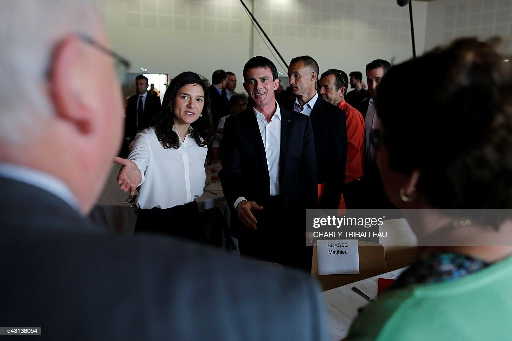 French Prime Minister Manuel Valls arrives to the 'Banquet Republicain' with Seine-Maritime departmental delegate Marie Le Vern (L) on June 26, 2016 in Belleville-sur-Mer, northwestern France. French Prime Minister Manuel Valls on Sunday said he opposed the TTIP transatlantic trade treaty currently under negotiation on the grounds that it was against 'EU interests'. 'No free trade agreement should be concluded if it does not respect EU interests. Europe should be firm,' Valls told members of the governing Socialist Party, adding 'France will be vigilant about this.' / AFP / CHARLY
