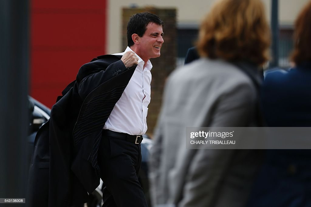 French Prime Minister Manuel Valls arrives to the 'Banquet Republicain' on June 26, 2016 in Belleville-sur-Mer, northwestern France. French Prime Minister Manuel Valls on Sunday said he opposed the TTIP transatlantic trade treaty currently under negotiation on the grounds that it was against 'EU interests'. 'No free trade agreement should be concluded if it does not respect EU interests. Europe should be firm,' Valls told members of the governing Socialist Party, adding 'France will be vigilant about this.' / AFP / CHARLY