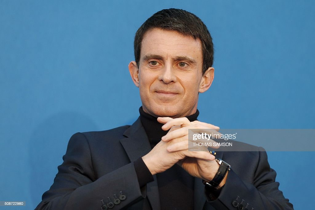 French Prime minister Manuel Valls attends the inauguration of the new Rosa Parks railway station in Paris on February 6, 2016. / AFP / THOMAS SAMSON