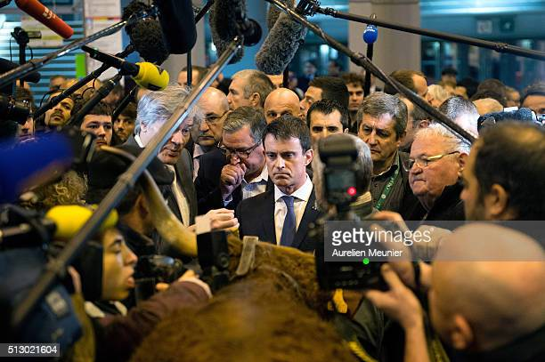 French Prime Minister Manuel Valls attends the Salon de l'Agriculture on the third day at Parc des Expositions at the Porte de Versailles on February...
