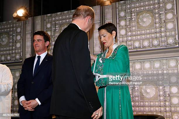 French Prime Minister Manuel Valls Bishop of Evry awarded Michel Dubost and HRH The Princess Lalla Meryem of Morocco who delivers the insignia of the...