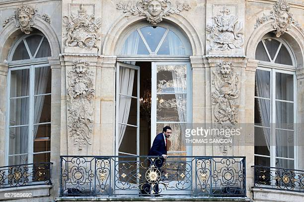 French Prime Minister Manuel Valls' cabinet director Sebastien Gros stands at a balcony at the Hotel Matignon in Paris on December 6 following the...