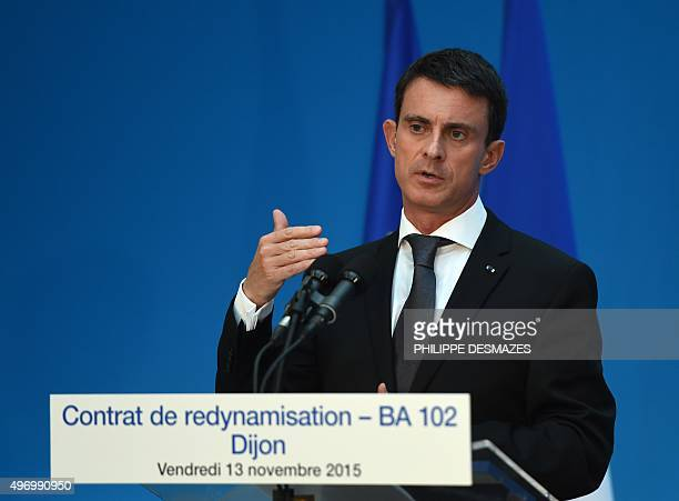 French Prime Minister Manuel Valls delivers a speech as he presents the revitalization contract of the BA 102 DijonLongvic airbase on November 13...