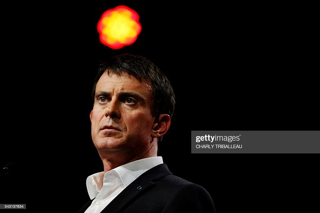 French Prime Minister Manuel Valls delivers a speech during the 'Banquet Republicain' on June 26, 2016 in Belleville-sur-Mer, northwestern France. French Prime Minister Manuel Valls on Sunday said he opposed the TTIP transatlantic trade treaty currently under negotiation on the grounds that it was against 'EU interests'. 'No free trade agreement should be concluded if it does not respect EU interests. Europe should be firm,' Valls told members of the governing Socialist Party, adding 'France will be vigilant about this.' / AFP / CHARLY