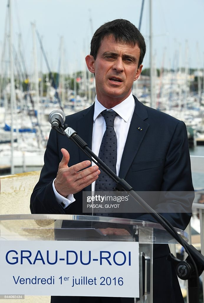French Prime Minister Manuel Valls delivers a speech on July 1, 2016, during his visit at Le Grau-du-Roi, southern France. / AFP / PASCAL