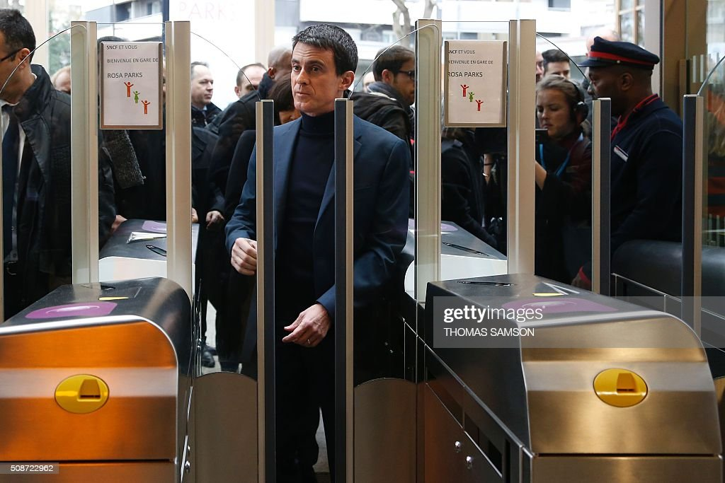 French Prime minister Manuel Valls enters the new Rosa Parks railway station during its inauguration on February 6, 2016 in Paris. / AFP / THOMAS SAMSON