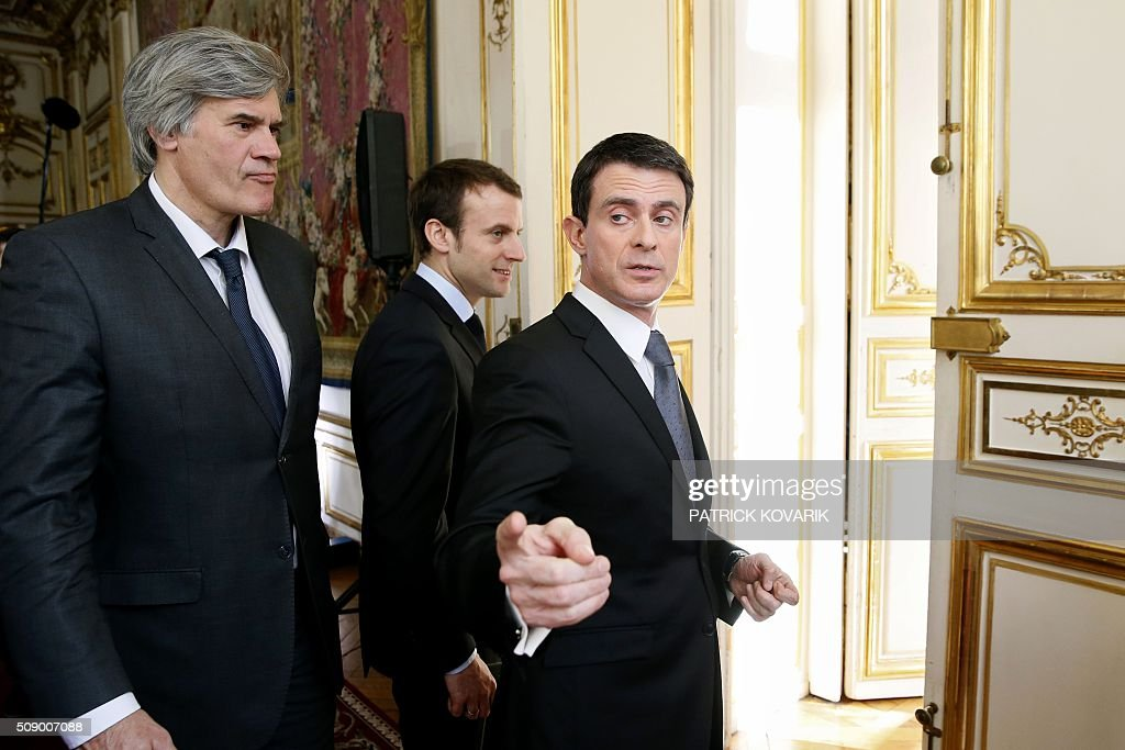 French Prime Minister Manuel Valls (R), French Agriculture minister and Government spokesperson Stephane Le Foll (L) and French Economy and Industry minister Emmanuel Macron leave after addressing a press conference following a meeting amid a crisis in France's agricultural sector in Paris on February 8, 2016. French farmers have carried out a string of demonstrations for nearly two weeks against the falling prices of their products, demanding structural measures to strengthen price rates. / AFP / PATRICK KOVARIK