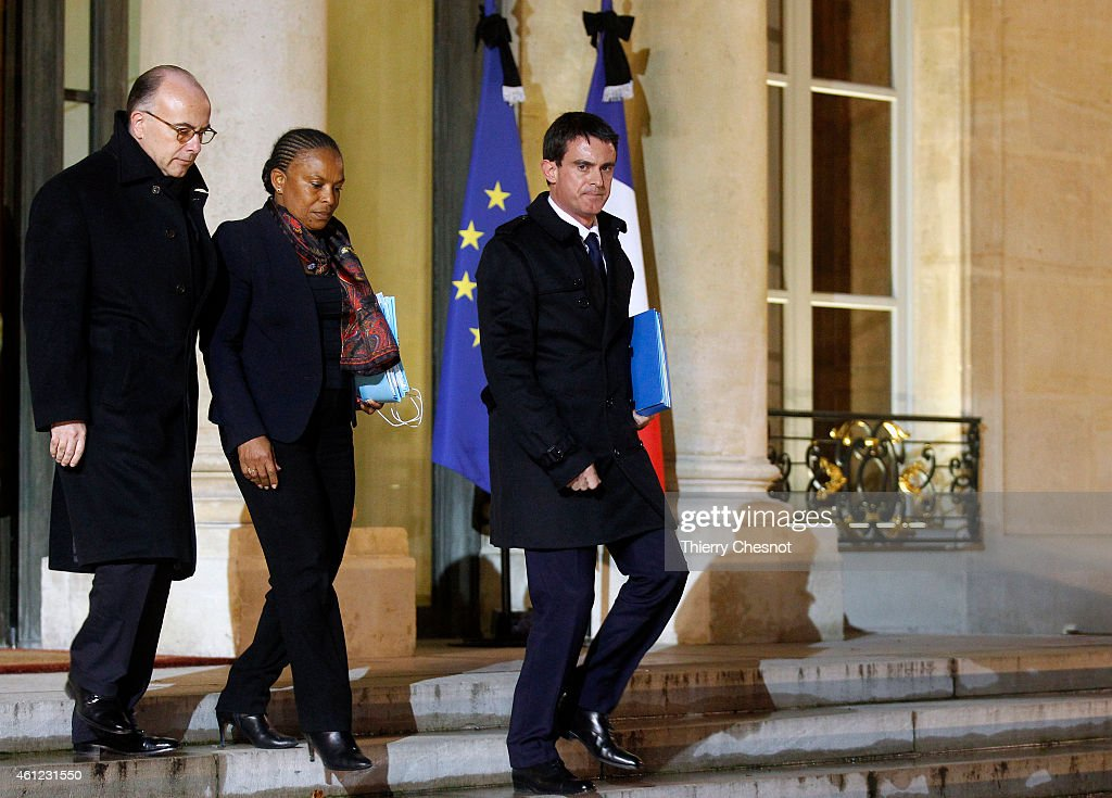 French Prime Minister Manuel Valls (R), French Justice Minister Christiane Taubira (C) and French Interior Minister Bernard Cazeneuve (L) leave the Elysee Palace after a crisis meeting at the Elysee Palace on January 9, 2015, in Paris, France. Both sieges in France are now believed to be over following operations by special forces police.