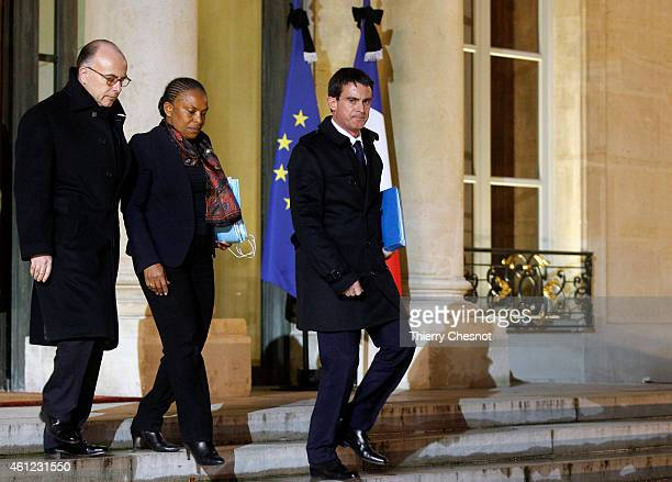 French Prime Minister Manuel Valls French Justice Minister Christiane Taubira and French Interior Minister Bernard Cazeneuve leave the Elysee Palace...