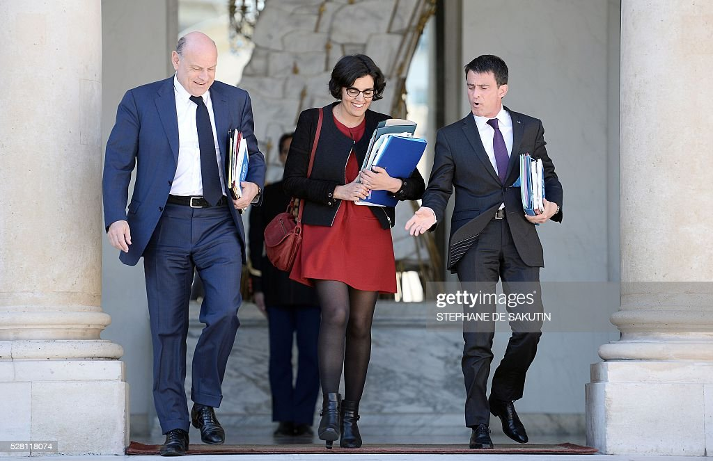 French Prime minister Manuel Valls (R), French Labour minister Myriam El Khomri (C) and French junior minister for Parliamentary Relations Jean-Marie Le Guen leave the Elysee presidential Palace after the weekly cabinet meeting in Paris on May 4, 2016 .
